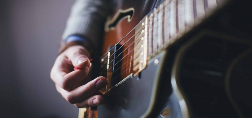 What is a guitar pick & how do you hold one?