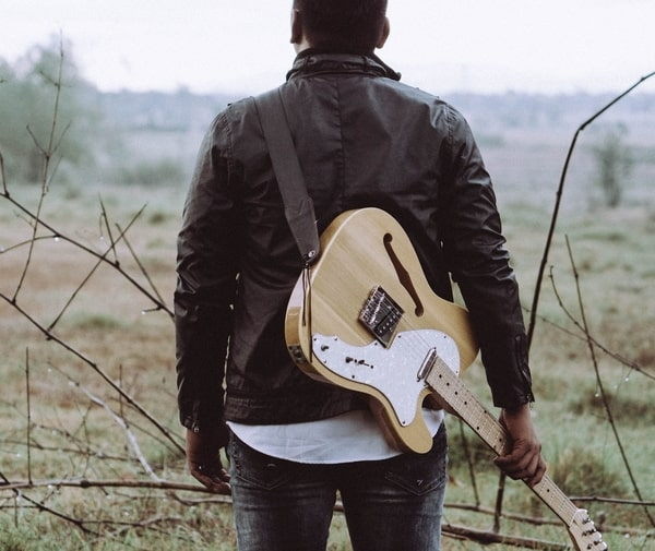 guitarist in the wilderness symbolising being isolated