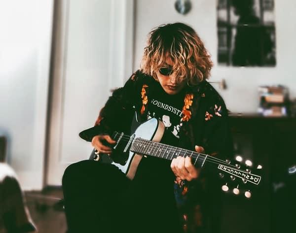guitarist practising at home