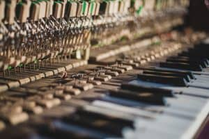 How to care for a piano: don't touch the insides of the piano