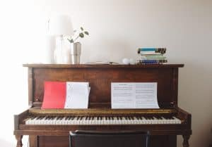 How to care for a piano: use mats for objects on top of a piano