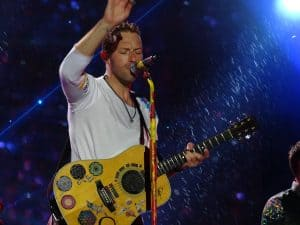 Chris Martin on stage singing with his signature sound