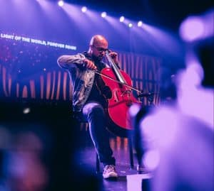 Man playing cello sitting on stage