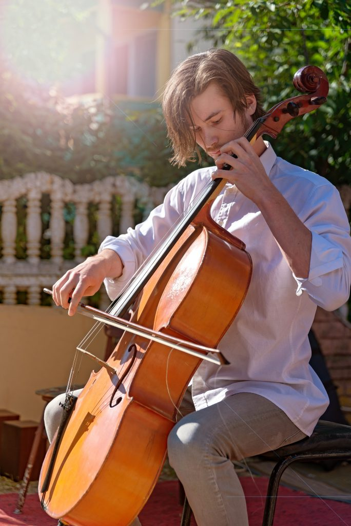man practising cello