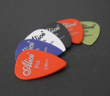 several guitar picks on a table