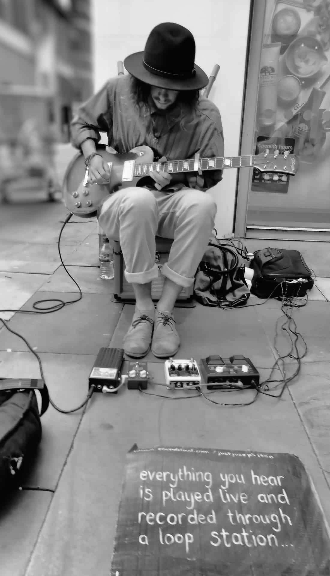 busker using a capo as part of his setup