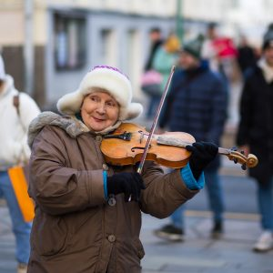 Lady having a lot of fun playing violin