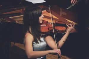 Professional violinist playing a concert
