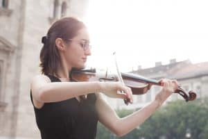 Violinist playing outside